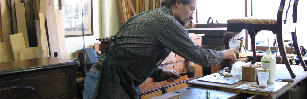 Erick Clingen restoring an antique chair in his Westchester County workshop